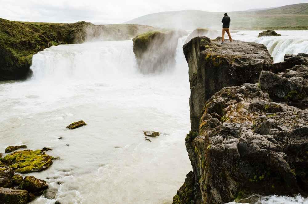 person stream cliff river